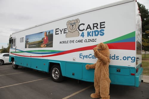 EyeCare4Kids mobile Clinic with bear waving