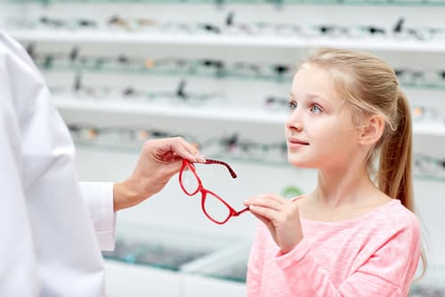 Little Girl Receiving Glasses